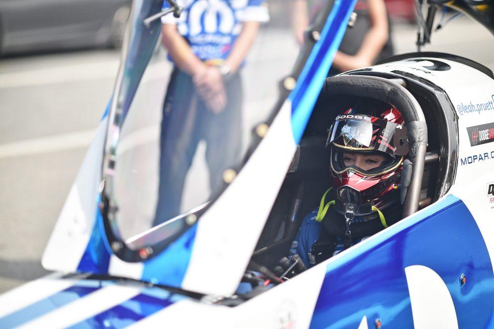 Leah Pruett sitting inside her top fuel car getting ready to race