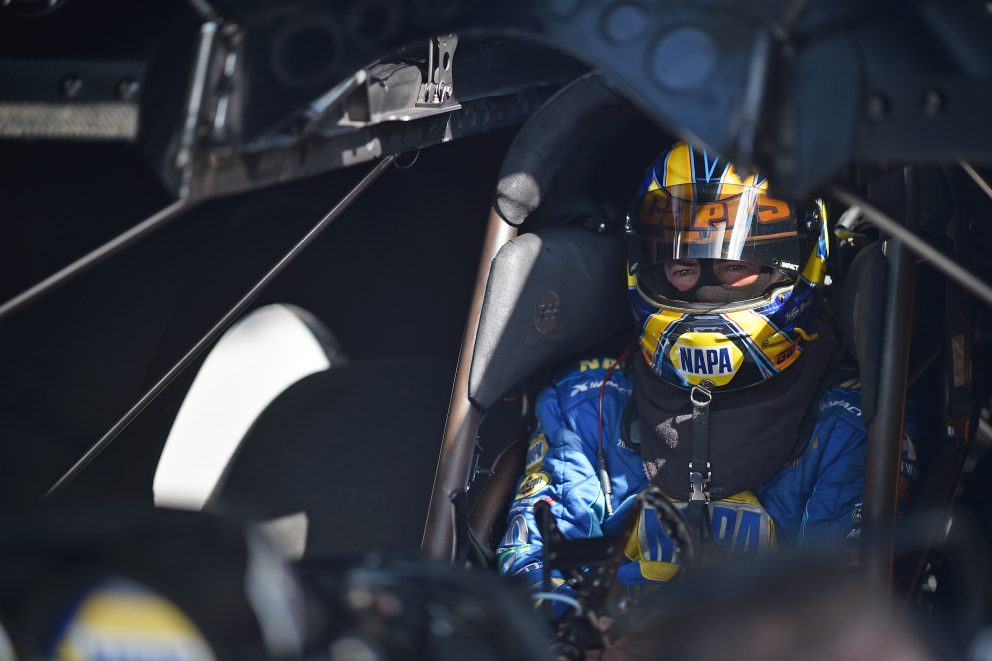 Ron Capps sitting in his funny car getting ready to race