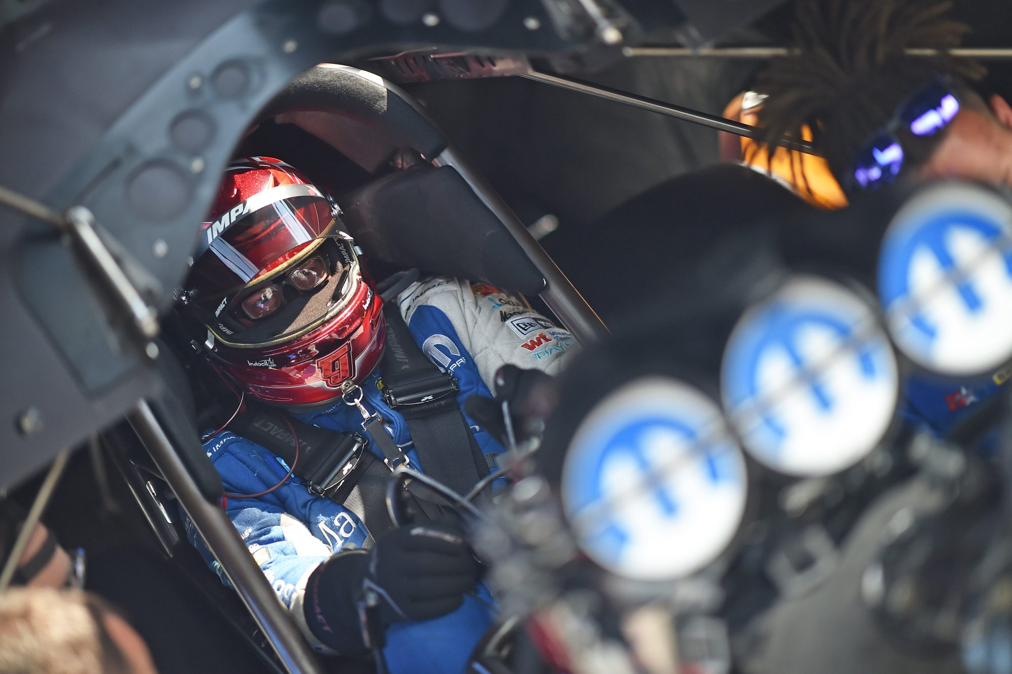 Tommy Johnson Jr sitting in his funny car getting ready to race