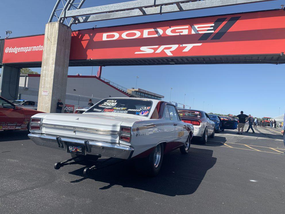Cars drag racing at NMCA