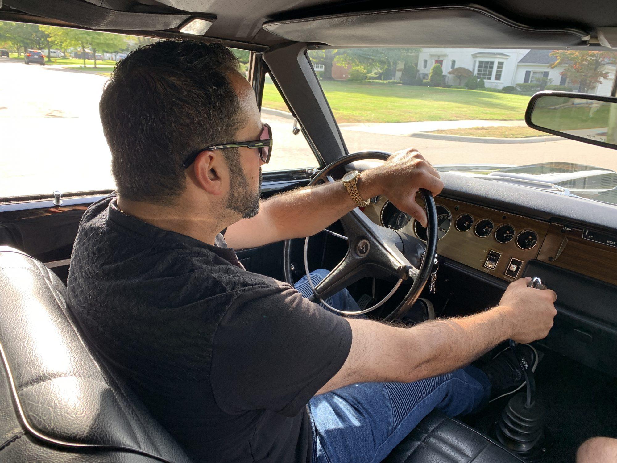 Man driving vintage Challenger