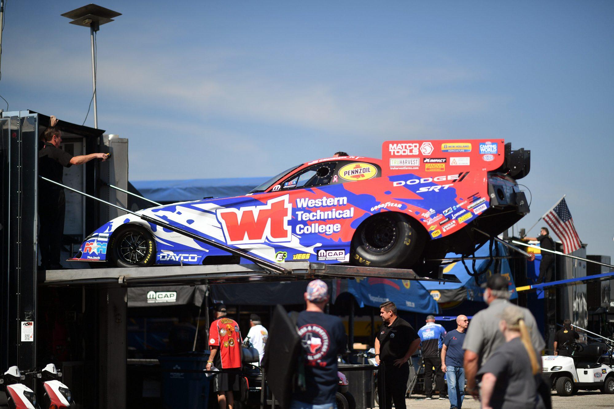 Matt Hagan's car coming off the trailer