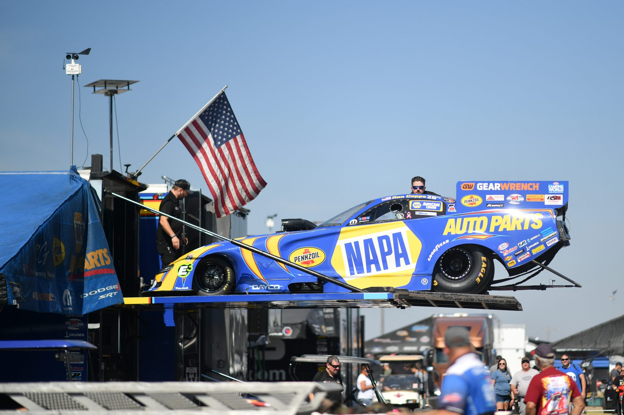 Ron Capps' car coming off the trailer