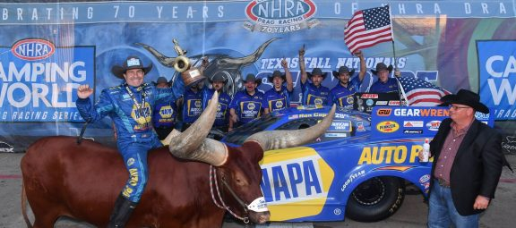 Ron Capps and hs team celebrating a win at NHRA FallNationals